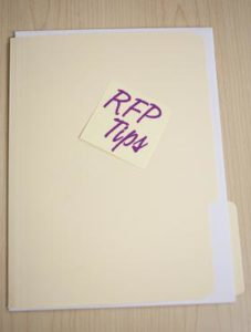 """manilla file folder with """"RFP tips"""" sticky note applied"""